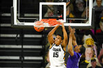 Iowa forward Keegan Murray (15) dunks the ball ahead of Northwestern guard Chase Audige, right, during the first half of an NCAA college basketball game, Tuesday, Dec. 29, 2020, in Iowa City, Iowa. (AP Photo/Charlie Neibergall)
