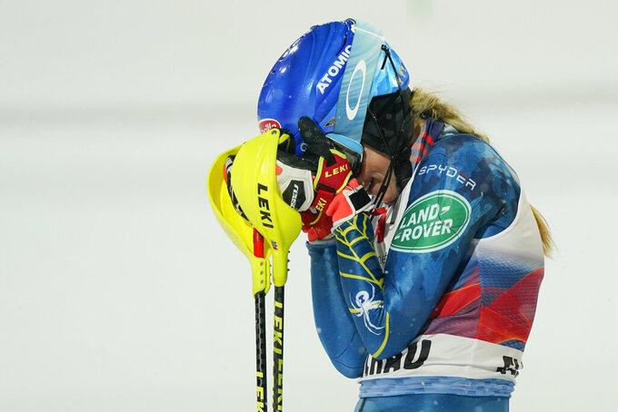 United States' Mikaela Shiffrin celebrates after winning an alpine ski, women's World Cup slalom in Flachau, Austria, Tuesday, Jan. 12, 2021. (AP Photo/Giovanni Auletta)