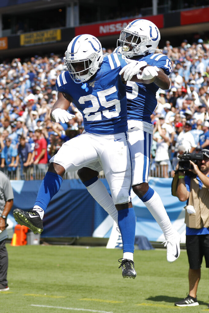 Indianapolis Colts wide receiver Parris Campbell, right, celebrates with running back Marlon Mack (25) after Campbell caught a touchdown pass against the Tennessee Titans in the first half of an NFL football game Sunday, Sept. 15, 2019, in Nashville, Tenn. (AP Photo/Wade Payne)