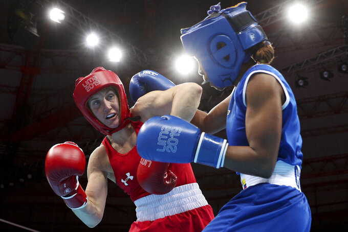 FILE - In this Aug. 2, 2019, file photo, Ingrit Valencia, right, of Colombia and Virginia Fuchs, of the United States compete in the women's flyweight boxing final bout at the Pan American Games in Lima, Peru. U.S. Olympic team boxer Fuchs will face no punishment for failing a doping test after the U.S. Anti-Doping Association determined the violation had been caused by two substances transmitted by her boyfriend through sex. USADA announced its ruling Thursday, June 11, 2020, clearing the 32-year-old Fuchs, who intends to qualify for the Tokyo Olympics next year as a flyweight. (AP Photo/Martin Mejia, File)
