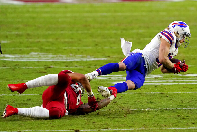 Arizona Cardinals linebacker Isaiah Simmons trips up Buffalo Bills wide receiver Cole Beasley, right, during the second half of an NFL football game, Sunday, Nov. 15, 2020, in Glendale, Ariz. (AP Photo/Rick Scuteri)