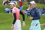Jessica Korda, right, wipes a tear after being congratulated by her sister Nelly Korda on the 18th green after winning in a one-hole playoff against Danielle Kang during the final round of the Tournament of Champions LPGA golf tournament, Sunday, Jan. 24, 2021, in Lake Buena Vista, Fla. (AP Photo/Phelan M. Ebenhack)