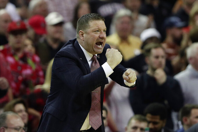 FILE - Texas Tech head coach Chris Beard signals to his players during the second half of an NCAA college basketball game against Texas in Austin, Texas, in this Saturday, Feb. 8, 2020, file photo. Texas Tech is technically still the reigning national runner-up since there was no NCAA Tournament played last season. The Red Raiders were on the floor warming up for their Big 12 tournament opener last March when the season suddenly stopped because of the novel coronavirus pandemic.(AP Photo/Eric Gay, File)