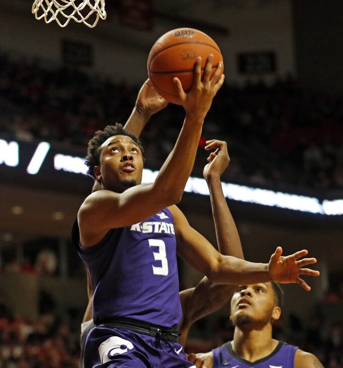 Kansas State's Kamau Stokes (3) lays up the ball during the first half of an NCAA college basketball game against Texas Tech, Saturday, Jan. 5, 2019, in Lubbock, Texas. (AP Photo/Brad Tollefson)