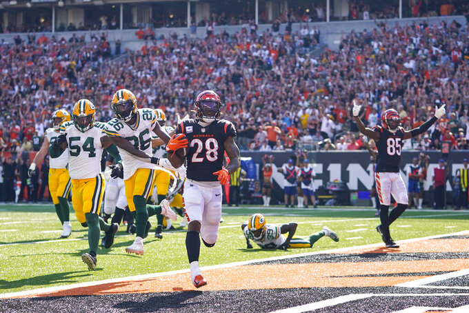 Cincinnati Bengals running back Joe Mixon (28) runs in for a touchdown against the Green Bay Packers in the second half of an NFL football game in Cincinnati, Sunday, Oct. 10, 2021. (AP Photo/Bryan Woolston)