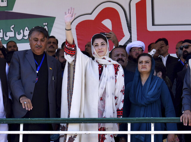 Maryam Nawaz, center, leader of the Pakistan Democratic Movement, waves to supporters upon her arrival to attend an anti government rally in Quetta, Pakistan, Sunday, Oct. 25, 2020. The top leaders of an alliance of Pakistan's major opposition parties have held rally in the southwestern Pakistani town as part of a campaign to oust the government of Prime Minister Imran Khan over his alleged failure in handling the country's economic crisis. (AP Photo/Arshad Butt)
