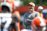 Cleveland Browns head coach Kevin Stefanski watches drills during an NFL football practice Thursday, Aug. 12, 2021, in Berea, Ohio. (AP Photo/Ron Schwane)