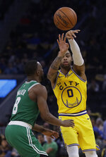 Golden State Warriors' D'Angelo Russell, right, passes the ball away from Boston Celtics' Kemba Walker during the second half of an NBA basketball game Friday, Nov. 15, 2019, in San Francisco. (AP Photo/Ben Margot)