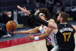 Detroit Pistons guard Frank Jackson (5) attempts a layup as Memphis Grizzlies center Jonas Valanciunas (17) defends during the first half of an NBA basketball game, Thursday, May 6, 2021, in Detroit. (AP Photo/Carlos Osorio)