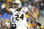 Missouri linebacker Terez Hall celebrates a tackle against Oklahoma State during the first half of the Liberty Bowl NCAA college football game in Memphis, Tenn., Monday, Dec. 31, 2018. (Joe Rondone/The Commercial Appeal via AP)