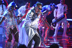 FILE - This Oct. 17, 2019, file photo, shows Ozuna performing at the Latin American Music Awards in Los Angeles. Ozuna will participate in the Macy's Thanksgiving Day Parade in New York City on Nov. 23. (Photo by Chris Pizzello/Invision/AP, File)