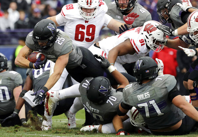 Northwestern running back Isaiah Bowser (25) scores a touchdown against Wisconsin during the second half of an NCAA college football game in Evanston, Ill., Saturday, Oct. 27, 2018. Northwestern won 31-17. (AP Photo/Nam Y. Huh)