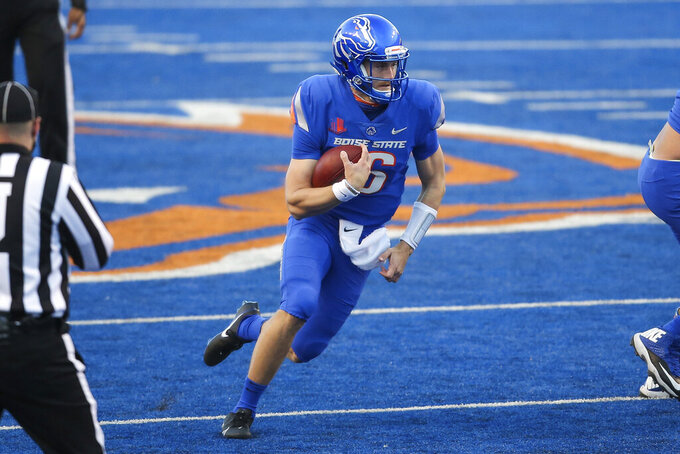 Boise State quarterback Jack Sears (16) scrambles with the ball in the first half against Utah State in an NCAA college football game Saturday, Oct. 24, 2020, in Boise, Idaho. Boise State won 42-13. (AP Photo/Steve Conner)