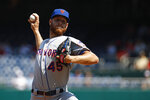 New York Mets starting pitcher Zack Wheeler throws to the Washington Nationals in the first inning of a baseball game, Wednesday, Sept. 4, 2019, in Washington. (AP Photo/Patrick Semansky)