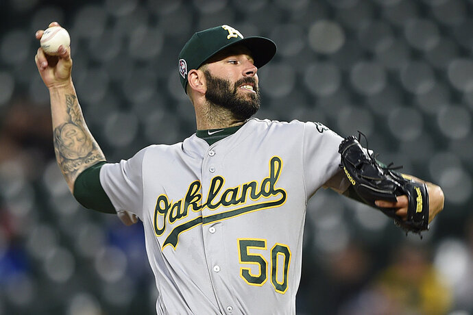 Oakland Athletics pitcher Mike Fiers throws against the Baltimore Orioles in the first inning of a baseball game, Tuesday, Sept. 11, 2018, in Baltimore. (AP Photo/Gail Burton)