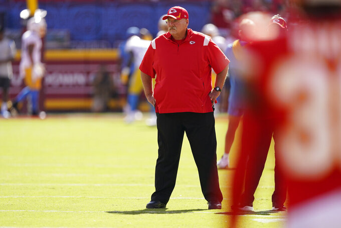 Kansas City Chiefs head coach Andy Reid watches as the teams warms-up before an NFL football game between the Kansas City Chiefs and the Los Angeles Chargers, Sunday, Sept. 26, 2021, in Kansas City, Mo. (AP Photo/Charlie Riedel)