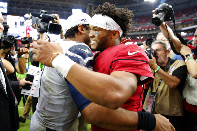 Seattle Seahawks quarterback Russell Wilson, left, and Arizona Cardinals quarterback Kyler Murray meet after an NFL football game, Sunday, Sept. 29, 2019, in Glendale, Ariz. The Seahawks won 27-10. (AP Photo/Rick Scuteri)