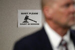 A sign is seen on the wall of a courtroom in a new ten facility during a walkthrough of the Migration Protection Protocols Immigration Hearing Facility, Tuesday, Sept. 17, 2019, in Laredo, Texas. (AP Photo/Eric Gay)