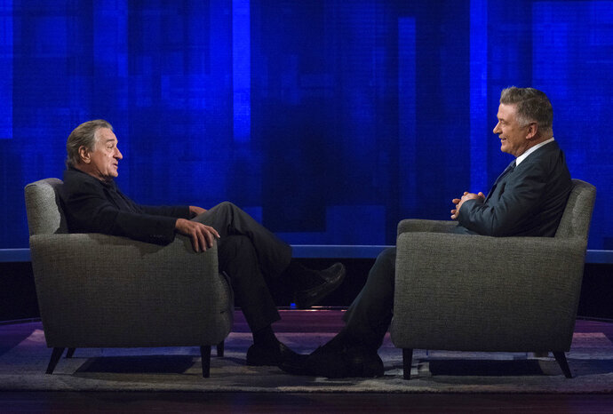 This image released by ABC shows host Alec Baldwin, right, speaking with actor Robert De Niro during an appearance on