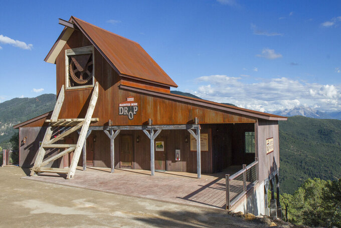 FILE - The Haunted Mine Drop is shown in this July 2017 file photo at Glenwood Caverns Adventure Park in Glenwood Springs, Colo.  A report from Colorado state investigators, Friday, Sept. 24, 2021, says a 6-year-old girl who died in a fall from a theme park ride over Labor Day weekend wasn't wearing the ride seatbelts, and operators of the vertical drop ride didn't properly check the restraints. (Chelsea Self/Glenwood Springs Post Independent via AP, File)