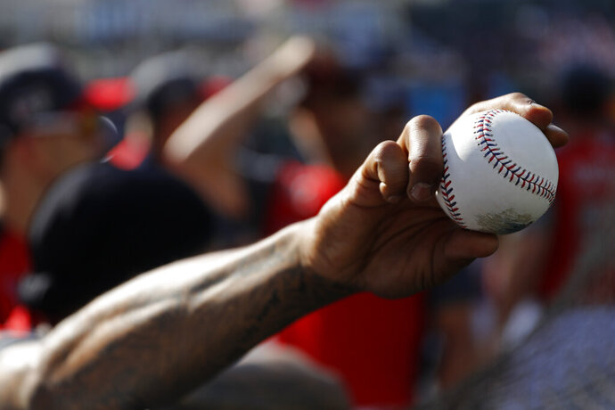 Marcus Stroman, of the Toronto Blue Jays, holds a baseball as the American League players take batting practice before the MLB baseball All-Star Game, Tuesday, July 9, 2019, in Cleveland. (AP Photo/John Minchillo)