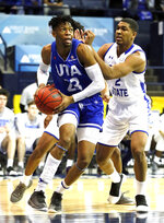 Texas-Arlington forward Patrick Mwamba (23) drives past Georgia State forward Malik Benlevi (2) during the first half of the NCAA college basketball championship game of the Sun Belt Conference men's tournament in in New Orleans, Sunday, March 17, 2019. (AP Photo/Tyler Kaufman)