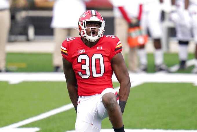 Maryland linebacker Durell Nchami reacts after recording a sack on Rutgers quarterback Noah Vedral during the first half of an NCAA college football game, Saturday, Dec. 12, 2020, in College Park, Md. (AP Photo/Julio Cortez)