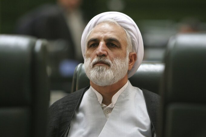 FILE - In this Aug. 21, 2005 file photo, former Iranian Intelligence Minister Gholamhossein Mohseni Ejehilistens to a speech during a session of parliament in Tehran, Iran. On Thursday, July 1, 2021, Ayatollah Ali Khamenei, Iran's supreme leader, appointed Ejehi as the new judiciary chief to replace former Judiciary Chief Ebrahim Raisi, the man recently elected as the country's new president. (AP Photo/Vahid Salemi, File)