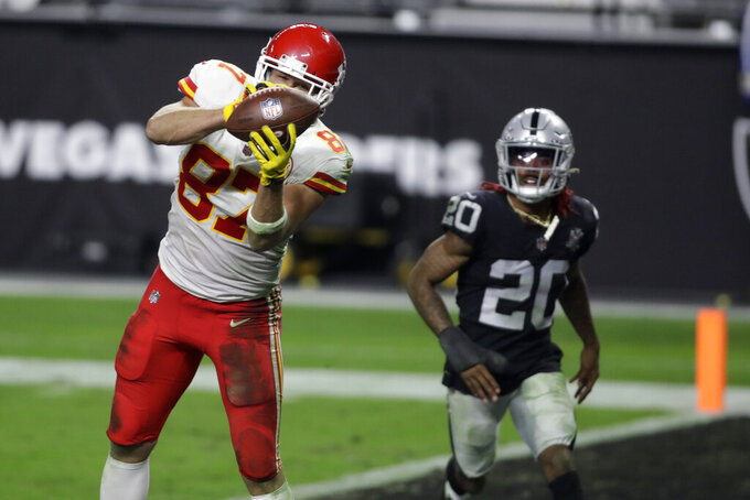 Kansas City Chiefs tight end Travis Kelce (87) catches a pass for a touchdown against the Las Vegas Raiders during the second half of an NFL football game, Sunday, Nov. 22, 2020, in Las Vegas. (AP Photo/Isaac Brekken)