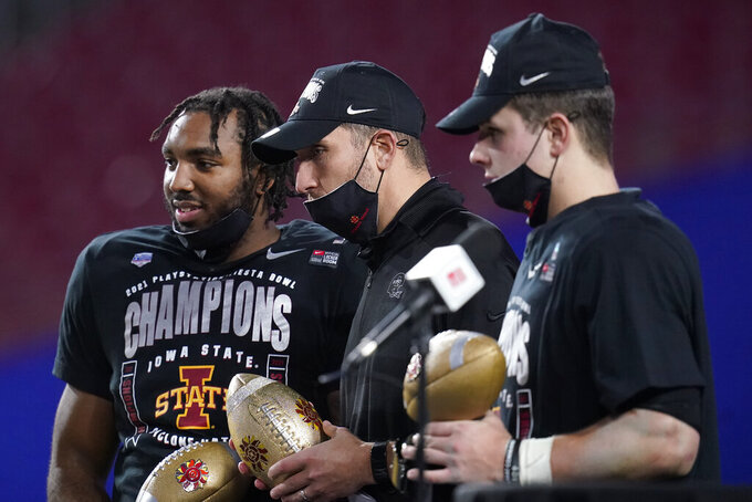 From left; Iowa State linebacker and defensive player of the game O'Rien Vance, head coach Matt Campbell and offense player of the game, quarterback Brock Purdy celebrate after the Fiesta Bowl NCAA college football game against Oregon, Saturday, Jan. 2, 2021, in Glendale, Ariz. Iowa State won 34-17. (AP Photo/Ross D. Franklin)