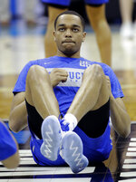 Kentucky's PJ Washington stretches during practice for the NCAA men's college basketball tournament Thursday, March 28, 2019, in Kansas City, Mo. Kentucky plays Houston in a Midwest Regional semifinal game on Friday. (AP Photo/Charlie Riedel)