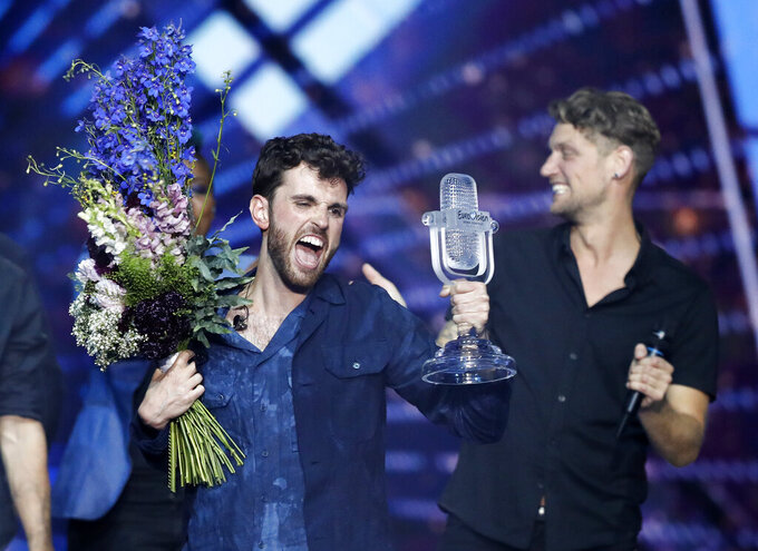 FILE - In this Saturday, May 18, 2019 file photo, Duncan Laurence of the Netherlands celebrates after winning the 2019 Eurovision Song Contest grand final in Tel Aviv, Israel. Organizers of the 2021 Eurovision Song Contest have welcomed the news that up to 3,500 fans may be allowed to attend the popular music competition when it is staged in the Netherlands in May 2021. The Dutch government has said it plans to make the annual contest of singers representing their countries part of a series of test events it is using to evaluate how to safely reopen large-scale public events amid the coronavirus pandemic. (AP Photo/Sebastian Scheiner, File)