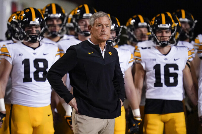 Iowa head coach Kirk Ferentz look son before his team takes the field during an NCAA college football game against Maryland, Friday, Oct. 1, 2021, in College Park, Md. (AP Photo/Julio Cortez)