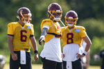 Washington quarterbacks Steven Montez (6), Dwayne Haskins Jr., (7) and Kyle Allen (8) work during practice at the team's NFL football training facility, Thursday, Aug. 20, 2020, in Ashburn, Va. (AP Photo/Alex Brandon)