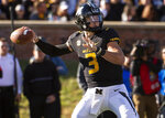 FILE - In this Saturday, Oct. 20, 2018, file photo, Missouri quarterback Drew Lock throws a pass during the first half of an NCAA college football game against Memphis in Columbia, Mo. Lock picked apart Florida's secondary in 2017, throwing for three touchdowns. The two teams meet again on Saturday. (AP Photo/L.G. Patterson, File)