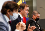 Belgian Prime Minister Alexander De Croo, center, speaks during a media conference, after a meeting with federal and regional officials regarding COVID-19 measures, in Brussels, Wednesday, April 14, 2021. (Frederic Sierakowski, Pool via AP)