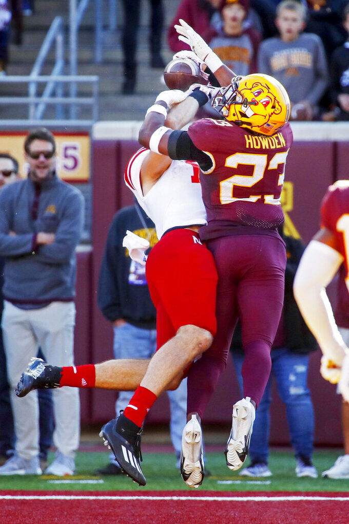 Nebraska tight end Austin Allen (11) brings in a catch for a touchdown as Minnesota defensive back Jordan Howden (23) defends in the fourth quarter of an NCAA college football game Saturday, Oct. 16, 2021, in Minneapolis. Minnesota won 30-23. (AP Photo/Bruce Kluckhohn)