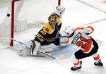 Boston Bruins goaltender Tuukka Rask (40) deflects a penalty shot taken by Philadelphia Flyers center Scott Laughton (21) in the third period of an NHL hockey game, Thursday, Jan. 31, 2019, in Boston. (AP Photo/Elise Amendola)