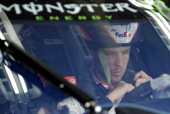 Denny Hamlin is seen in his car during practice for Sunday's NASCAR Cup Series auto race at Charlotte Motor Speedway in Concord, N.C., Saturday, Sept. 28, 2019. (AP Photo/Mike McCarn)