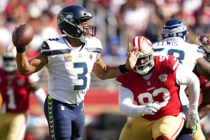 Seattle Seahawks quarterback Russell Wilson (3) passes in front of San Francisco 49ers defensive tackle D.J. Jones during the second half of an NFL football game in Santa Clara, Calif., Sunday, Oct. 3, 2021. (AP Photo/Tony Avelar)