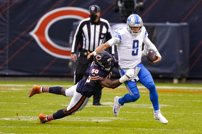 Chicago Bears outside linebacker Barkevious Mingo (50) tackles Detroit Lions quarterback Matthew Stafford (9) in the first half of an NFL football game in Chicago, Sunday, Dec. 6, 2020. (AP Photo/Nam Y. Huh)