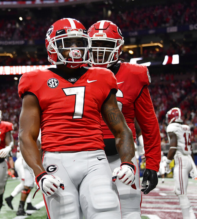 Georgia running back D'Andre Swift (7) celebrates his touchdown against Alabama during the first half of the Southeastern Conference championship NCAA college football game, Saturday, Dec. 1, 2018, in Atlanta. (AP Photo/John Amis)