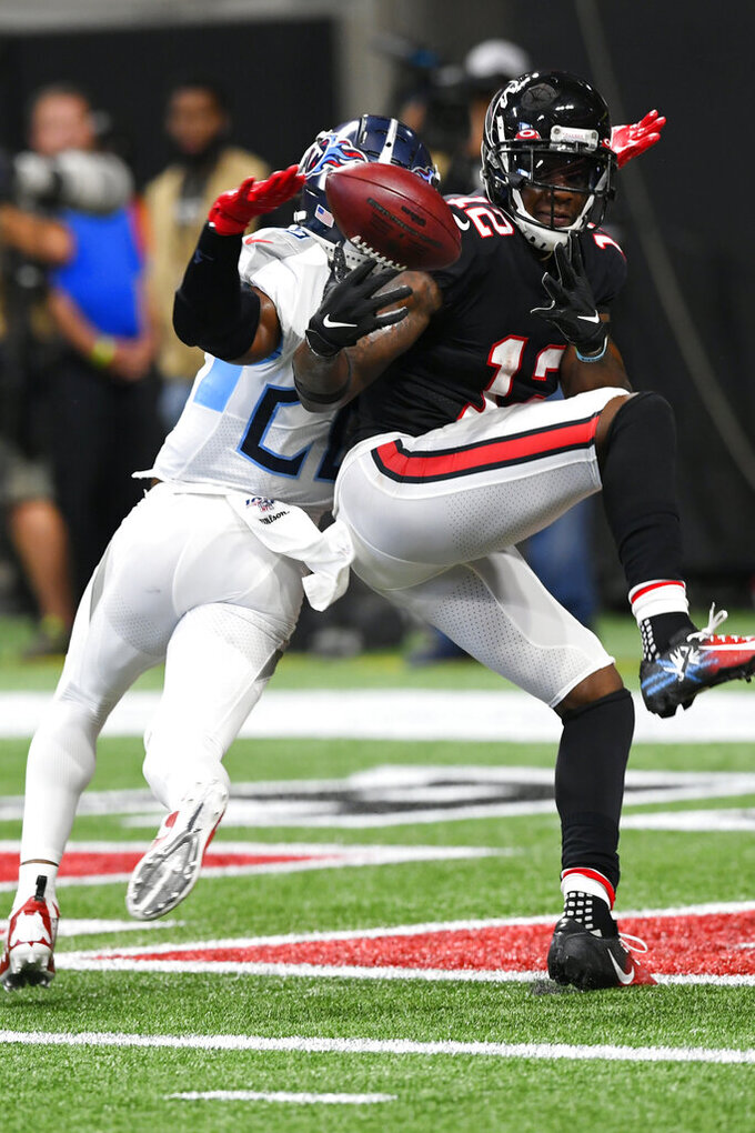 Atlanta Falcons wide receiver Mohamed Sanu (12) misses the catch against Tennessee Titans cornerback Logan Ryan (26) during the second half of an NFL football game, Sunday, Sept. 29, 2019, in Atlanta. (AP Photo/John Amis)