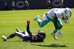 Miami Dolphins running back Myles Gaskin, right, is tackled by Chicago Bears cornerback Duke Shelley during the first half of an NFL preseason football game in Chicago, Saturday, Aug. 14, 2021. (AP Photo/Nam Y. Huh)