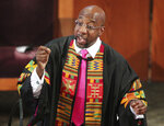FILE- In this June 23, 2020, file photo, Rev. Raphael G. Warnock delivers the eulogy for Rayshard Brooks' funeral at Ebenezer Baptist Church in Atlanta. A pair of new high-profile endorsements are adding fuel to an already contentious special election for a U.S. Senate seat in Georgia.  Former president Jimmy Carter endorsed Democrat Raphael Warnock in the race. (Curtis Compton/Atlanta Journal-Constitution via AP, Pool)