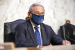 Sen. Bob Menendez, D-N.J., arrives at a Senate Foreign Relations Committee on Capitol Hill in Washington, Wednesday, Aug. 4, 2021. (AP Photo/Amanda Andrade-Rhoades)