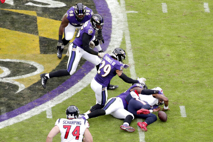 Houston Texans quarterback Deshaun Watson, right, fumbles the ball while being sacked by Baltimore Ravens outside linebacker Matt Judon during the first half of an NFL football game, Sunday, Nov. 17, 2019, in Baltimore. (AP Photo/Julio Cortez)