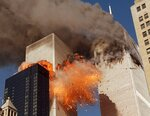 FILE - Smoke billows from one of the towers of the World Trade Center and flames and debris explode from the second tower, Tuesday, Sept. 11, 2001. (AP Photo/Chao Soi Cheong, File)