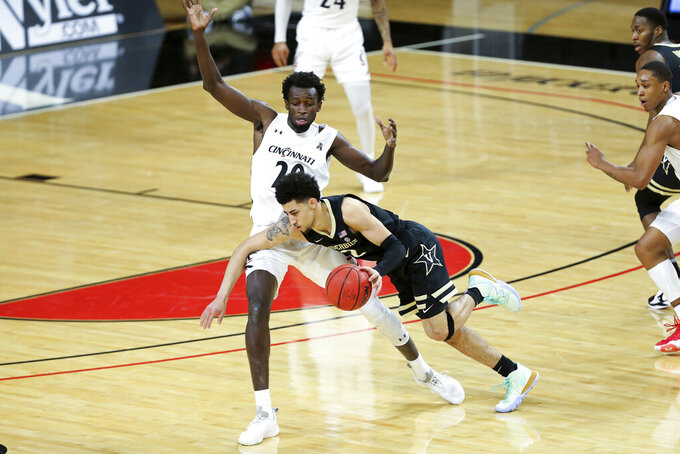 Vanderbilt guard Scotty Pippen Jr. (2) fouled by Cincinnati forward Mamoudou Diarra (20) outside the three-point line in the first half of an NCAA college basketball game Thursday, March 4, 2021, in Cincinnati. (Kareem Elgazzar/The Cincinnati Enquirer via AP)