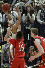 California guard Matt Bradley, top left, shoots over Utah guard Rylan Jones (15) and center Branden Carlson during the first half of an NCAA college basketball game in Berkeley, Calif., Saturday, Feb. 29, 2020. (AP Photo/Jeff Chiu)